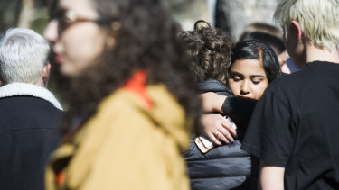 Survivors and students comfort each other as they call on ANU to do more, a year on from a landmark report into sexual violence on campus.