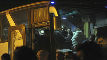 Syrian government forces overseeing the evacuation by buses of rebel fighters and their families in Arbeen, in the eastern Ghouta region near Damascus, Syria.