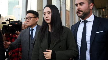 Xuan Dong, the wife of Chinese actor Yunxiang Gao, leaves court on Friday.