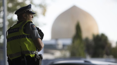 A policeman stands guard in front of the Al Noor mosque in Christchurch.