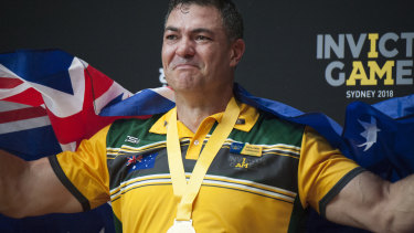 Ben Farinazzo collects one of his two gold medals at the 2018 Invictus Games