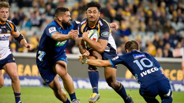 Brumbies centre Irae Simone on the charge against the Blues.