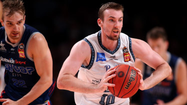 Melbourne's Mitch McCarron in action against the Adelaide 36ers.