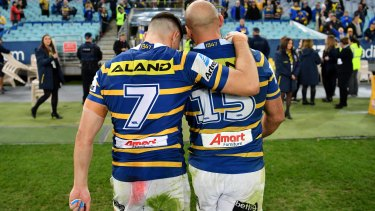 Mitchell Moses and Tim Mannah together after a game against the Bulldogs in 2018.