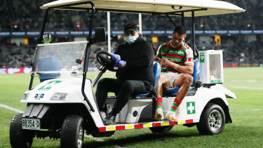 The Souths centre is carted off after dislocating his right kneecap against the Bulldogs last July.