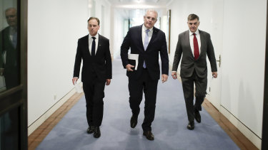 Health Minister Greg Hunt (left), Prime Minister Scott Morrison and Chief Medical Officer Professor Brendan Murphy in early March.