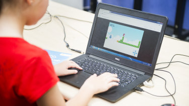 Matilda Bowen playing the game she made during the Code Camp at Holy Spirit Primary School.