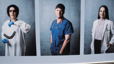 Professor David Story (centre) features in a photo essay installed in Parkville as part of Metro Tunnel's creative program.