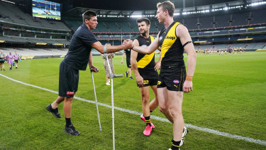 Get well soon: Tigers Dylan Grimes and Trent Cotchin (right) console injured Blue Matthew Kreuzer.