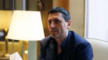 French writer Frederic Martel gestures during an interview with Associated Press, in Paris.