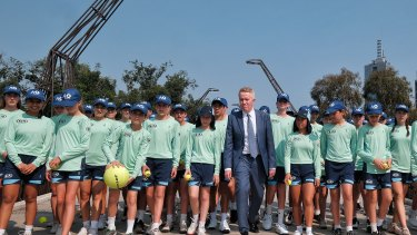 Craig Tiley poses with ball kids before this year's Australian Open in Melbourne.