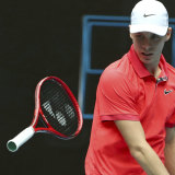Denis Shapovalov throws his racquet in frustration during his first round match against Marton Fucsovics at the Australian Open.