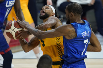 Patty Mills, who starred for the Boomers, is fouled by Kevin Durant.