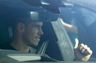 Gareth Bale gives fans the thumbs up as he arrives at Tottenham's training ground.