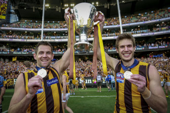 Luke Hodge and Grant Birchall celebrate the Hawks' 2015 premiership.