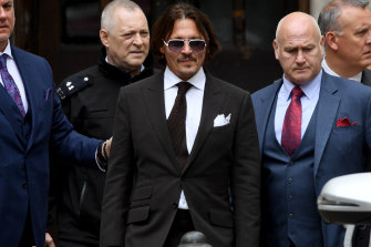 Johnny Depp, centre, leaves court in London on Friday.