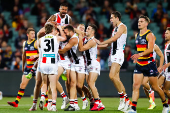 St Kilda players come from everywhere to celebrate Dougal Howard's first goal in club colours.