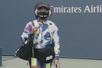 Osaka enters the arena for the 2020 US Open wearing a facemask bearing the name of Tamir Rice, a 12-year-old boy who was shot dead by police in Cleveland in 2014.