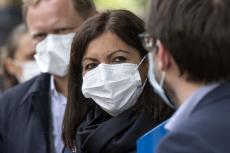 Paris mayor Anne Hidalgo and other officials in Paris on Tuesday after the easing of restrictions.