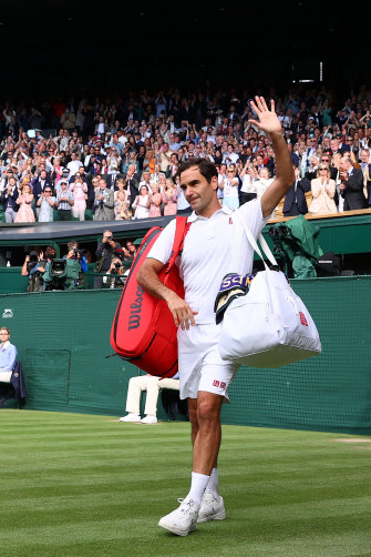 Federer waves to the Wimbledon crowd after being knocked out in the quarter-finals this year.
