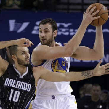 Andrew Bogut, right, playing for the Golden State Warriors in an NBA game in California in 2014.
