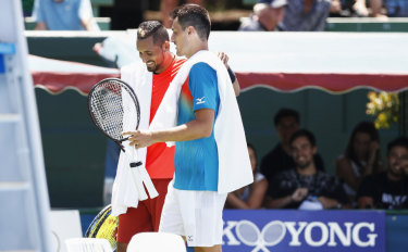 Nick Kyrgios (right) and Bernard Tomic after their friendly at Kooyong.