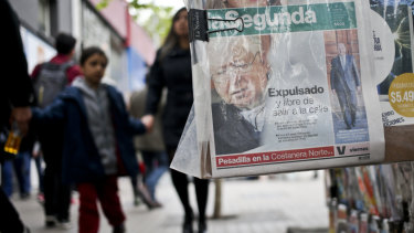 A local newspaper shows a newspaper front page about the defrocking of priest Fernando Karadima by Pope Francis, in Santiago, Chile.