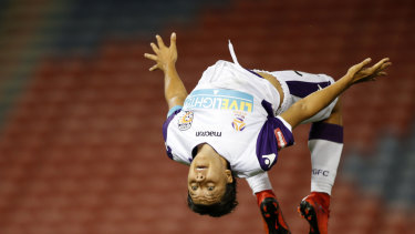 Sam Kerr does a backflip after scoring a hat-trick for Perth Glory during the W-League Round 8 match between the Newcastle Jets and Perth Glory in 2017.