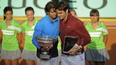 Rafael Nadal with Roger Federer, after beating the Swiss in the 2011 French Open final.