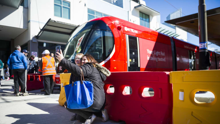 Jesse Nixon, 4, and Lyndal Nixon take a selfie in front of the new tram.
