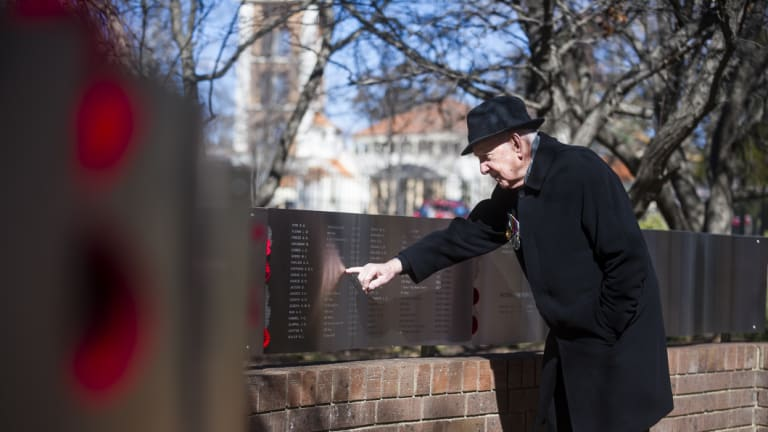 First ever national Australian Jewish War Memorial at the ACT Jewish Community Centre. Jules Hoffman points to his brother's name.