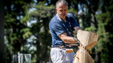 Andrew Wiseman, the show's woodchopping sector head, demonstrating the skill.