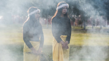 Bella and Bo House at a smoking ceremony to mark Reconciliation Day in Canberra on Monday morning.