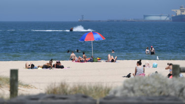 Beachgoers at Port Melbourne beach on Thursday.