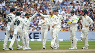 Nathan Lyon celebrates with teammates after dismissing Moeen Ali.