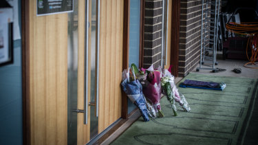 Bunches of flowers left in sympathy after the New Zealand shootings at the door of the Gungahlin mosque.