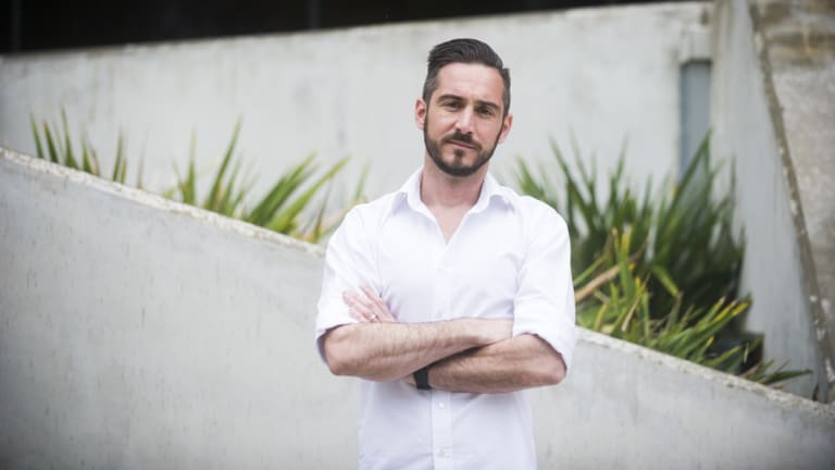 Assistant professor at University of Canberra Eamon Merrick says he and colleagues are burning out, forced to work long nights and weekends to meet unsustainable workloads.