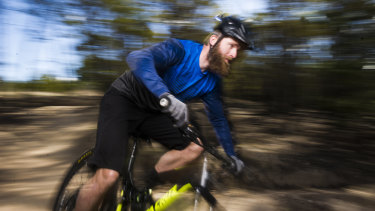 Mountain biker Josh Kentwell, who is calling on the ACT government to fund new and more challenging trails at Mt Stromlo.