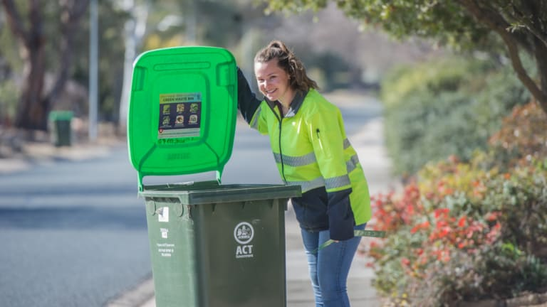 Envirocom environment education officer Kathryn Sullivan inspecting green waste bins in Kambah. Green waste bins are being randomly inspected to see who is or who isn't doing the right thing .