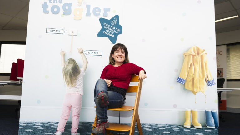 Peta Stammell in front of The Toggler, which acts as a light switch extender for children or adults.