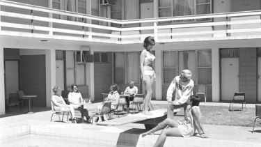 """Alice Springs, 1970. """"A man kicks back in a freshly ironed pair of slacks, while a woman in a bikini wonders why he's wearing a woollen jumper,"""" notes Tim Ross."""
