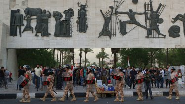Iraqi security forces close Tahrir Square while protesters gather demanding services and jobs in central Baghdad, on  Saturday, July 14.