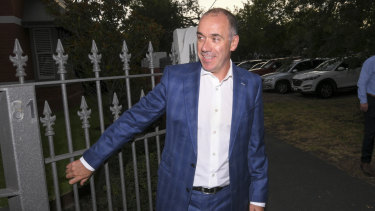 Outgoing National Australia Bank CEO Andrew Thorburn speaks to the media outside his home on Thursday.