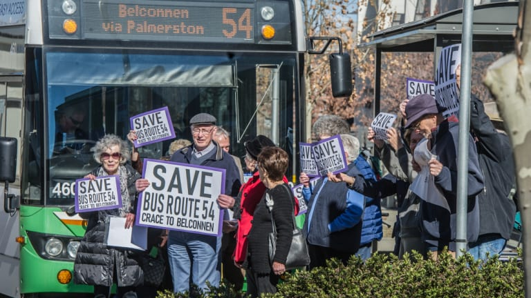 Residents of Goodwin Retirement Village and supportive neighbours in Crace hold a silent demonstration to protest the government's proposed changes to their bus route. They briefly stepped out in front of the 11.22am bus.