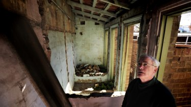 Goulburn Parish priest Father Dermid McDermott walks around the decommissioned toilets that sparked the Goulburn Catholic School strike in July 1962.