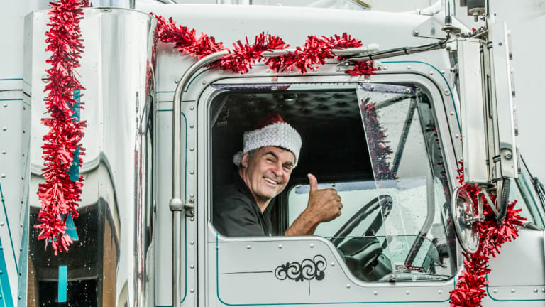 Tony Innaimo's trucks delivered the Christmas care packages to the country families.