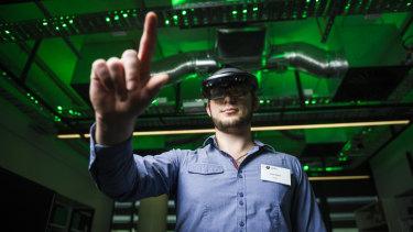 AR application developer Simon Malnar inside the CSIRO's Data61 immersive environment lab.