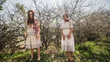 'We've never been outside in our costumes before,' the actresses laughed before taking selfies in front of a blossoming cherry tree.