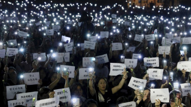 "Hundreds of mothers holding placards, some of which read ""If we lose the young generation, what's left of Hong Kong"", and lit smartphones protest against the amendments to the extradition law in Hong Kong."