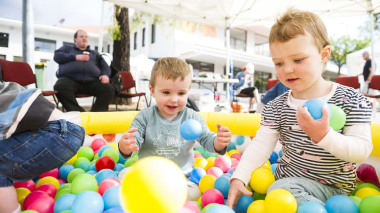 Mason Hutton, one, and Chloe Carwardine, two, in the play area run by the Salvation Army at SouthFest on Saturday.